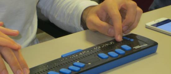 A person using a Braille display